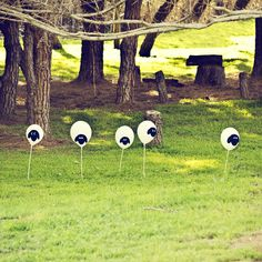 Shaun the Sheep Birthday Party DIY Decorations.   Sheep dotted the land to greet guests upon their arrival! Created with black marker on white balloon on balloon stake. I used felt for some of the sheep faces.