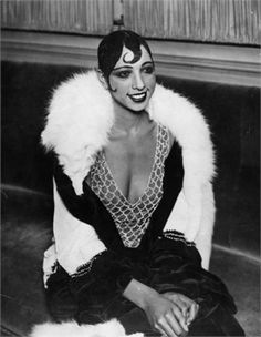 La Baker with signature plastered curls. She has a fabulous story! Harlem Renaissance Fashion | She moved to France and became an instant success for her dancing ...
