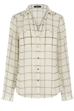 Gridlock isn't so bad when it's printed over our favourite oversized shirt, and this chiffon check shirt will no doubt become one of our all time favourite staples. The rolled up sleeves and oversized fit mean that this is a pretty casual top, yet dressed with suit trousers and a blazer this would look more than suitable for the boardroom.