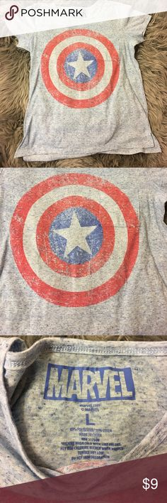 Women's Large Marvel T Shirt Great condition. Marvel shirt. 85% polyester and 15% linen. Small chest pocket. Bust measures 20 inches. Shoulder to bottom of shirt is 26'inches Marvel Tops Tees - Short Sleeve