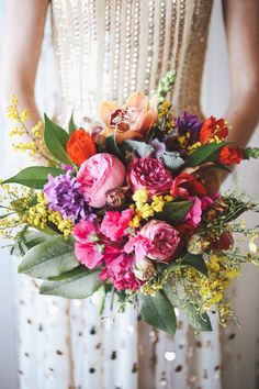 Tropical bridal bouquet | Lara Hotz Photography for Hitched Magazine | http://burnettsboards.com/2013/11/birds-paradise-indie-wedding-inspiration/