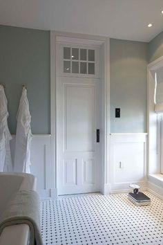 classic bathroom, icy blue, black and white, moldings