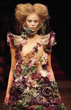 Alexander McQueen - Dress   Sarabande, spring/summer 2007.   Nude silk organza embroidered with silk flowers and fresh flowers.