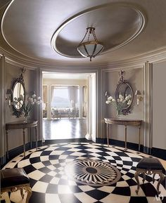 Tiled with Belgian marble, the foyer floor makes a dramatic statement in a San Francisco apartment devised by decorator Suzanne Tucker and architect Andrew Skurman | archdigest.com