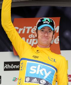 British Bradley Wiggins celebrates on the podium on June 04 , 2012 in Saint-Vallier at the end of the first stage of the 64rd edition of the Dauphine Criterium cycling race run between Seyssins and Saint-Vallier. AFP PHOTO/PASCAL PAVANIPASCAL PAVANI/AFP/GettyImages