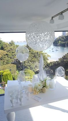 3ft clear jumbo balloon with white confetti and white tassel garland. www.balloons.net.au