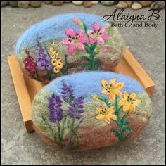 Felted Soap - These felted floral landscapes soaps have been very popular. These two feature a cold process handcrafted soap in a ginger lime fragrance encased in merino wool landscape design. They are further decorated by needle felting the lilies, lavender and gladiolus flowers. Just beautiful. By Alaiyna B. Bath and Body