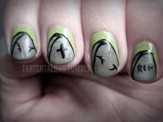 These tombstone-inspired nails by Maiya Becker of Tarts N Talons are great for giving off the creepy vibe without actually spending time in a foggy graveyard.