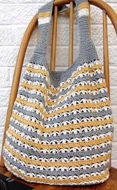 Bag crocheted yarn in three colors. More Patterns Like This!