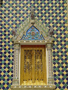 This door at the Emerald Buddha Temple in Wat Phra Kaew, Bangkok, Thailand is definitely colorful! :)