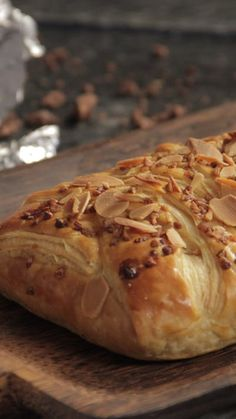 Recipe with video instructions: Move over cream — chocolate and pralines are the new tasty duo. Ingredients: 1 milk chocolate bar, 1 puff pastry, 1 egg, Diced almonds, Pralines
