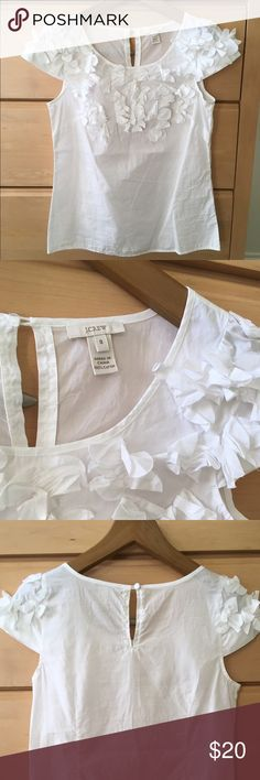 J. Crew floral ruffle white top Darling J. Crew short sleeve top. Flower detail. Buttons in back. Loose fitting with seams in front. 100% cotton. Looks great with jeans or tucked into a skirt. No stains or missing flowers. In great condition. J. Crew Tops