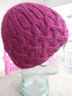 Free knitting pattern for Cathedral Hat by Sarah Hood beanie with cables