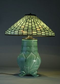 Plain geometric cone shaped Tiffany Studios shade on a Rookwood Pottery base, ca. Tiffany used art pottery of a small number of lamps he made. Old Lamps, Antique Lamps, Vintage Lamps, Vintage Pottery, Vintage Lighting, Pottery Art, Vintage Ceramic, Tiffany Stained Glass, Stained Glass Lamps