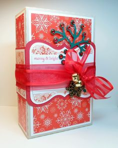 """Christmas Box"" that I made using my Silhouette Cameo, the ""Deck the Halls"" from Beth Silaika for Gina K Designs, Gina K. Designs Pure Luxury 80 lb layering weight card stock, patterned paper from the Gina K. Designs ""Blizzard"" pattern pape  r pack and Gina K. Designs Pure Luxury red ribbon. All of the paper products and ribbon can be found in the Gina K. Designs online store at StampTV. http://www.shop.ginakdesigns.com/main.sc"