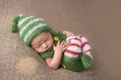 Newborn footed Elf outfit, sitter elf outfit, The perfect photo prop  Little striped footed leggings with green shorts A cropped top A matching elf hat.  Made to order Newborn size to 9 months old (sitter size)  Handwash and lay flat to dry  Please note buttons may be plain wooden ones, depending on availability of the yellow buttons, but will be very similar. Made from soft, brushed South African Mohair yarn, sourced locally in Port Elizabeth, from a network of local farmers, chosen for its…