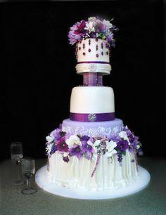 Lavender wedding cake! - Beautiful shades of purple lavender adorn  this wedding cake.