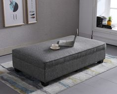 Jammy is a long rectangular footstool available in leather and fabric.  It has matching piping around the edge and sits nicely on 4 wooden feet.
