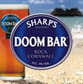 """Sharp's Doom Bar Beer has achieved international cult status and is the No.1 selling cask beer in the UK! .. Where the river Camel meets the Atlantic Ocean on Cornwall's rugged north coast, a sand bank, centuries old, known as the Doom Bar protects and calms this beautiful estuary. Sailors respect the Doom Bar knowing it to be unforgiving if met with haste or arrogance."""