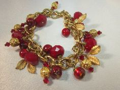 Beaded Bracelet Red Quartz Crystals, Faceted Quartz, Gold Leaf Charms, Gold Link Chain  By: MoonwitchDesigns