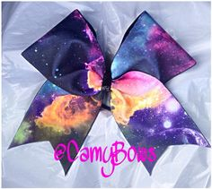 Galaxy Print Spandex on 3 Black Grosgrain Ribbon. This fabric has a unique pattern so each bow will look a little different than this one. Types Of Galaxies, Galaxy Print, Cheer Bows, Cheerleading, Amethyst, Arts And Crafts, Crystals, Space, Trending Outfits