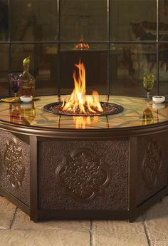Warm up while enjoying chilly fall nights with your guests with the Imperial Custom Gas Fire Table that  provides constant warm heat and a breathtaking stained glass counter ideal for drinks or appetizers.