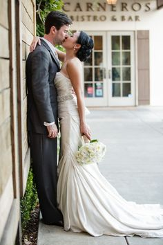 The newlyweds steal a sweet kiss! {Diane Askew Photography}