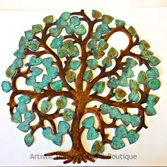 Fall Tree, hand made by artists in Haiti from recycled oil barrels. Painted with Modern Masters Metal Effects reactive paints by Rachel Gingold and available at Artistic Home Studio & Boutique.
