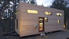 """Home is a tiny house that cost just US$33k in total to build: Owners release the plans. (This is a great house! 28x8.5"""" with two lofts, and stairs to the main loft. (I would swap the kitchen and living room area as I don't need much of a kitchen, put a single bed/couch in the living room, and reduce the window and use of glass due to Manitoba's brutal -40 winters. I LOVE the large propane stove for heat!) <3"""