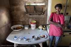 """""""Marble Moahi, a mother living with HIV/AIDS, in the family kitchen in Kabakae Village, Ghanzi, Botswana with her typical day's worth of foo..."""