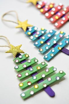 DIY Popsicle Stick Christmas Tree Ornaments - DIY Christmas Ornaments For Kids gifts diy for kids 13 DIY Holiday Ornaments Kids Can Make - Pretty My Party - Party Ideas Popsicle Stick Christmas Crafts, Stick Christmas Tree, Dollar Store Christmas, Easy Christmas Crafts, Homemade Christmas Gifts, Craft Stick Crafts, Christmas Tree Ornaments, Fun Crafts, Craft Kids