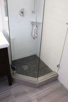 "Beautiful Bathroom Renovation Project Featuring 4"" x 12"" Subway Tiles, 12"" x 24"" Porcelain Floor Tiles, Riobel Shower Fixtures, Neo Angle Shower With 1"" x 1"" Hexagon Mosaic Tiles, Kohler Toilet, Kohler Vanity Top With Kohler Vanity, Custom Frameless Shower Glass, And Floor Ditra-Heat By Schluter Systems."