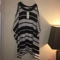 Striped pancho Black and white striped pancho with cut out in shoulder. No side seams, just one pullover piece. Sweaters Shrugs & Ponchos