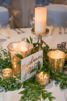Centerpieces | gold and greenery |candles