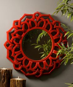 Calantha Red Wall Mirror - The Calantha mirror is a dramatic, sultry statement mirror in a bold red symmetrical patterned frame. IMAX exclusive!