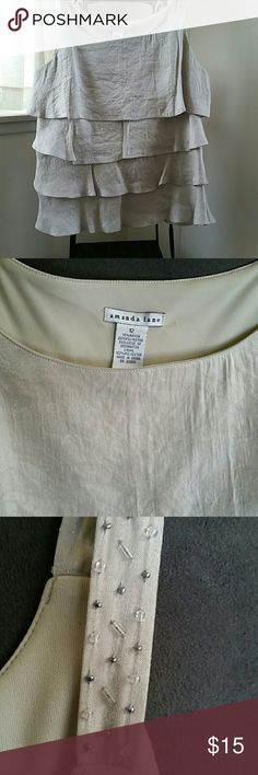 Tiered Strapped Top Gold like tan in color. Worn once. Bead detailed straps. Very pretty shimmery top. Tops Tunics