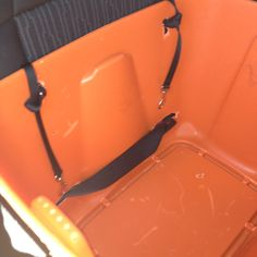 Homemade multi dog booster seat w cushions removed. Can see car seat belt through bottom and two short leads at top to attach to harnesses