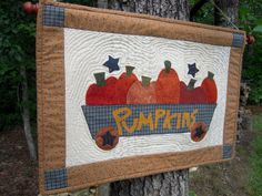Quilted Wall Hanging, Quilt,Country Decor, Primitive Decor, Autumn, Fall Wall hanging, Primitive Pumpkin Wagon. $28.00, via Etsy.