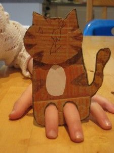 make a finger puppet using cardboard--could make a sheep puppet and glue cotton balls onto cardboard