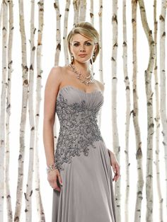 mon cheri bridals 211620 -     Strapless sweetheart chiffon A-line dress with ruched empire bust line, intricately hand-beaded and embroidered midriff with asymmetrically dropped waistline, full bias-cut gathered skirt. Matching shawl and removable straps included.
