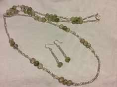 Prehnite, sterling silver wire and plated metal necklace and earrings.