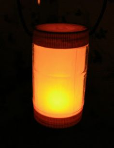 DIY Camping Lantern  Could this be done somehow with plastic pop bottles?  Draw designs on paper before inserting in bottle.
