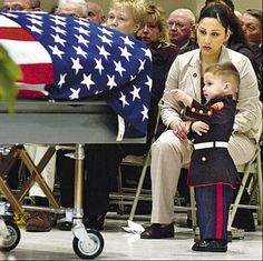 Two-year-old Tyler Miles wearing Marine dress blues and points at the flag-covered casket of his father, Marine Sergeant Sean H. Miles, who was killed in Iraq. Military Videos, Military Families, Military Love, Military Humor, Fallen Heroes, Fallen Soldiers, Support Our Troops, Real Hero, American Soldiers