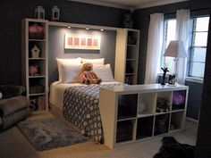 Instead of a headboard......Love the bookshelves 'framing' the bed, and especially love the lights over head for reading