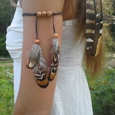 I love feathers in their natural state. So divine just the way they were created. Armband and headband Available in my etsy shop. Dieselboutique.etsy. com #armband #armcuff #armcandy #bohochic #bohostyle #vegas #edm #tribal #bohojewelry #boho #bohemian #gypsy #festivalfashion #feathers #edc #hippiestyle #hippiespirits #goodvibes #hippie #natural #vikings #highsociety #edclv #rainbow #urban #southern #festival #electricforest #featherarmband #plur