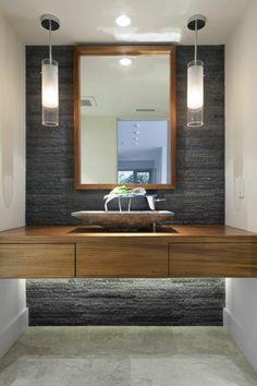 vasque salle de bain avec deux lampes bois et siphon en pierre