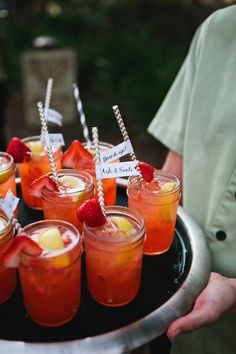 Bright #SignatureCocktails served in #MasonJars with adorably fun straws.  #cocktailhour Photography: Lauren Kinsey Fine Art Wedding Photography - laurenkinsey.com Read More: http://www.stylemepretty.com/2014/03/28/destination-wedding-at-watercolor-inn-resort/