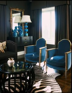 Love the gold accents--design indugences house beautiful blue foo dogs interior design zebra rug nailhead trim black walls My Living Room, Home And Living, Living Room Decor, Living Spaces, Coastal Living, Black Sofa, Black Walls, Brown Walls, Decoration Inspiration