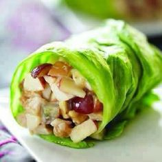 Chicken Apple Wraps  1/2 c cooked chopped skinless chicken breast - 3 Tbsp chopped apple - 2 Tbsp. chopped grapes - 2 Tbsp. Natural Peanut butter - 1 Tbsp Greek yogurt - 2 Tbsp Honey ( optional ) - Romaine lettuce DIRECTIONS - Mix all chopped ingredients in a bowl, add the rest of the ingredients and mix well. Spoon into lettuce leaf, roll & serve.