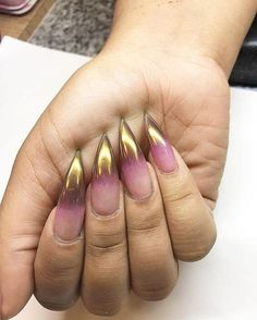 Clear, pink and gold gradient nails in a long claw shape
